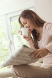 Reading the newspapers Stock Image