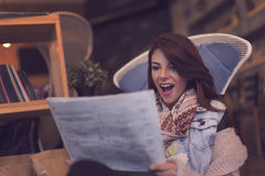Reading newspapers Stock Images