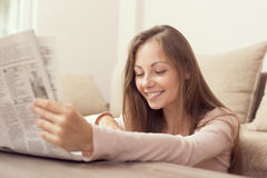 Reading newspapers Royalty Free Stock Photography