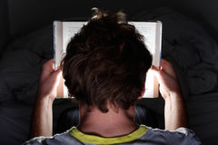 Reading at night royalty free stock photo