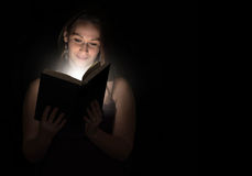 Reading at night stock photography
