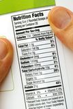 Reading nutrition facts on protein jar. Close-up Stock Images