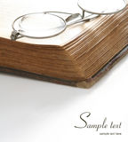 Reading Objects. A closeup view of metallic silver spectacles on an old book. Room for text available Stock Images