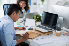Reading in office Stock Photography