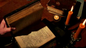 Reading Old Book Under Candlelight stock video