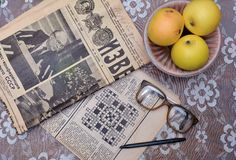 Reading old Soviet newspapers, vintage glasses Stock Images