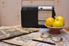 Reading old Soviet newspapers, vintage radio Stock Photo