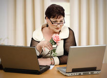 Reading online dating news on laptop Royalty Free Stock Images