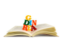 READING. An open book, from which letters emerge, creating the word 'READING Stock Photography