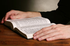 Reading open russian holy bible Stock Photo