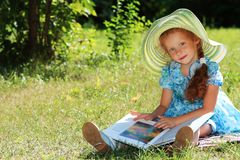 Reading outdoor Royalty Free Stock Image