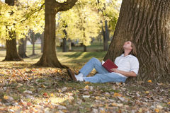 Reading outdoors Royalty Free Stock Images
