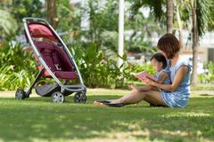 Reading outdoors Stock Image