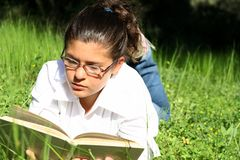 reading outdoors at summer camp Stock Photo