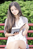 Reading outdoors Stock Photo