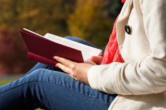 Reading outside Stock Photography