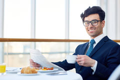 Reading paper by breakfast Royalty Free Stock Images