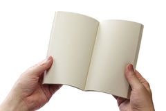 Reading paperback, blank pages opens Stock Photography