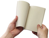Reading paperback, blank pages opens Stock Image