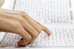 Reading paragraph of quran. Closeup of muslim hand pointing at paragraph of quran. Shot during the month of ramadan stock photography