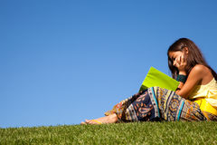 Reading at the park Royalty Free Stock Image