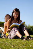 Reading at the park Stock Image
