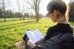 Reading in park Stock Images