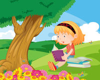Reading in the park Stock Image