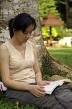 Reading at park. A beautiful day,perfect to scroll to the park and have a read Stock Photos