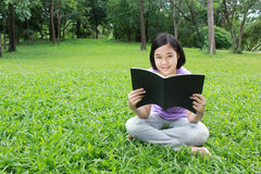 Reading in the park Stock Images