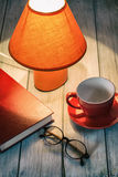 Reading pause for coffee. Living room interior and home decor concept. Toned image Stock Photography