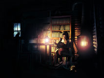 Reading peacefully. Woman living in a log cabin with her pets, a cat and a dog, and reading peacefully at night, close to the stove Stock Images