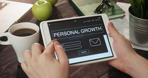 Reading personal growth landing page using tablet computer stock video