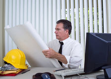 Reading the Plans Royalty Free Stock Photos