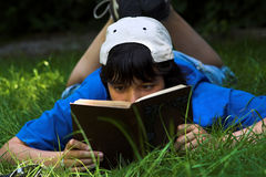 Reading Poetry. Teenage boy reading poetry book royalty free stock images