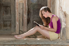 Reading on a porch Royalty Free Stock Image