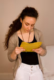 Reading post. Woman reading address on a letter Royalty Free Stock Image