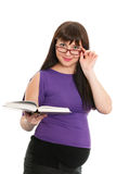 Reading pregnant lady in glasses Stock Images