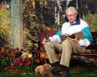 Reading with Pup Royalty Free Stock Photo