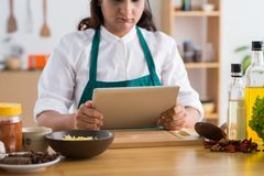 Reading a recipe Royalty Free Stock Image