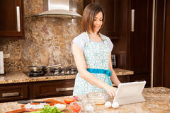Reading recipes on a tablet Royalty Free Stock Image