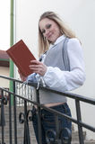 Reading and Relaxation Ideas. Portrait of Sensual Caucasian Blond Woman Reading Book Outdoors in City Stock Images
