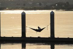 Reading relaxing on hammock boat dock royalty free stock images