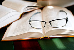 Reading and research. Open books with glasses resting on them royalty free stock images