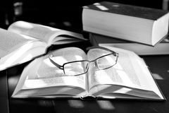 Reading and research. Open books with glasses resting on them stock photos
