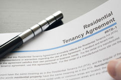 Reading residential tenancy agreement. Woman reading residential tenancy agreement Stock Photography