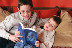 Reading Room. 2 brothers at home reading a book royalty free stock photos