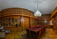 Reading room in old library. Reading room in old antique library, panorama Royalty Free Stock Photos