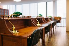 Reading room, rows of table in university library. Nobody. Knowledge depository, education stock photos