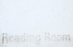 The Reading Room. A white marble plaque with the words, Reading Room carved into the stone surface.  Naturally high key image with texture detail and copy space Royalty Free Stock Photos